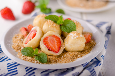 Stuffed strawberry dumplings, delish dessert with herbs Stock Photo