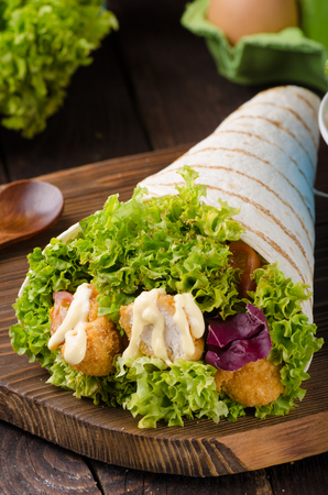 Grilled tortilla with chicken, mayo and tomato ketchuGrilled tortilla chicken, lettuce, homemade mayo and barbeque sauce, food photography
