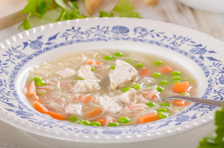 Spring chicken soup noodles, vegetable and toast, food photography, fresh and healthy soup Banque d'images - 104258802