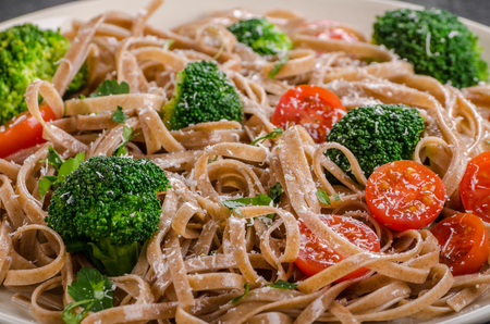 Broccoli pasta delish simple with tomatoes, parmesan cheese