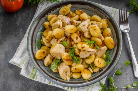 Fried gnocchi chicken curry, food photography, delish food with herbs