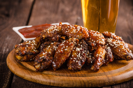 Grilled chicken wings with hot sauce. food photography, ready for advertisment Banco de Imagens