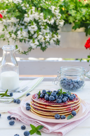 delish breakfast with fresh fruit on garden party, outside with flowers behind and fresh herbs on top Stok Fotoğraf - 108173513