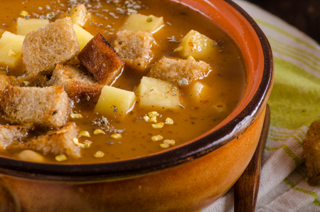 Goulash soup with croutons and potatoes, food photography