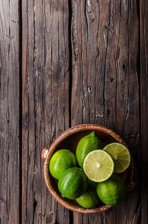 Fresh lime on wood board, bio fruit, food photography, food stock