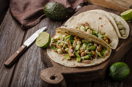 Homemade chicken thigh grilled, fresh avocado in tortilla Stock Photo