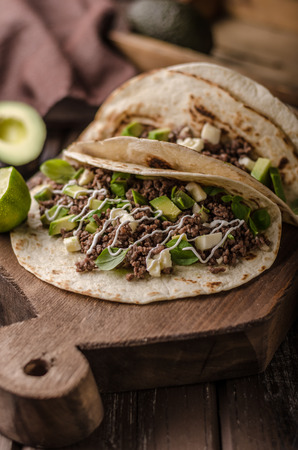Homemade minced beef tortilla, fresh avocado and mozarella cheese delish food simple cooking, fresh ingredience Stock Photo