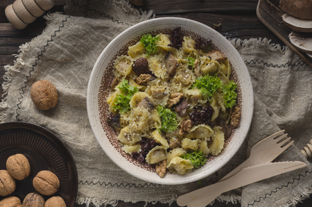 Homemade tortellini with mushrooms and walnuts, simple food photography with on vintage napkin