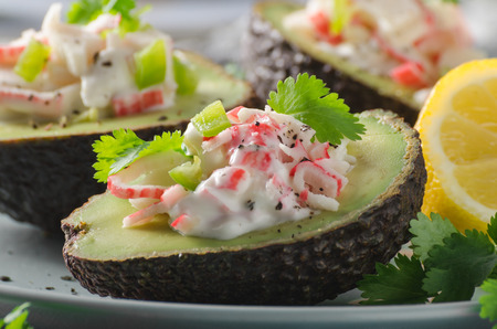 Bio organic avocado filled with homemade mayo, crab meat and herbs