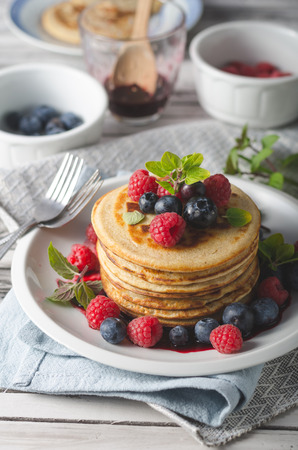 Fresh pick up forest fruit with wholegrain pancakes with fruit sauce