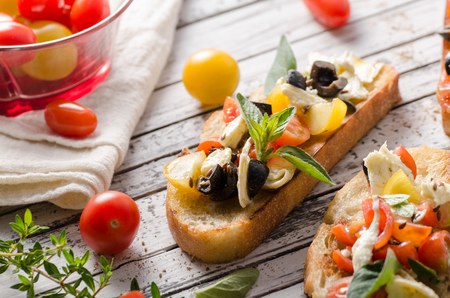 Delish simple food, roasted homemade bread with garlic and herbs, fresh vegetable and cheese