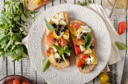Delish simple food, roasted homemade bread with garlic and herbs, fresh vegetable and cheese Stock Photo