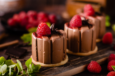 Delicious dessert with dark chocolate and fresh raspberry inside