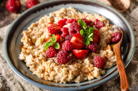 Delicious breakfast with fresh berries, cinnamon and mint