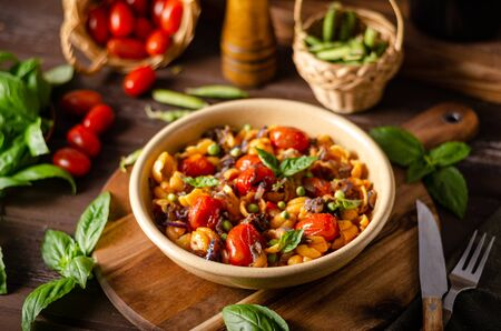 Fresh and simple food, homemade pasta with balsamico tomatoes and herbs Stock Photo