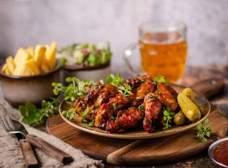 Spicy chicken wings with barbecue sauce, delicious and simple food Imagens