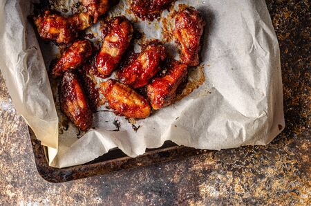 Spicy chicken wings with barbecue sauce, delicious and simple food