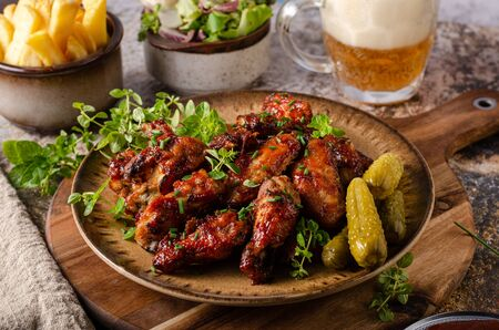 Spicy chicken wings with barbecue sauce, delicious and simple food 免版税图像