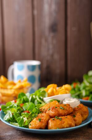 Fish and homemade french fries with delicious tartar sauce.