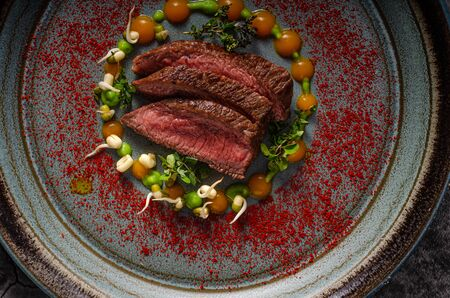 Delicous medium rare steak on plate, beautiful food styling 写真素材