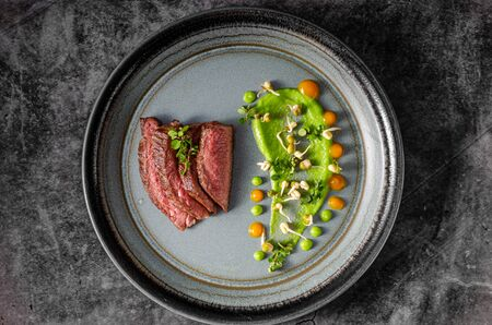 Delicous medium rare steak on plate, beautiful food styling Stock fotó