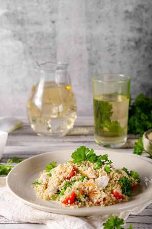 Bio couscous with chicken meat, tomatoes and fresh herbs Stock fotó