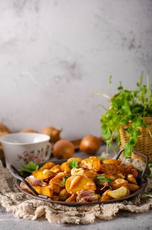 Delicious and simple food with roasted potato, bio garlic and herbs