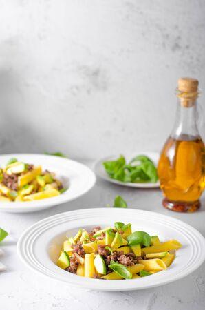 Bio organic avocado and garlic in semolina pasta, fresh beef meat Фото со стока - 134216483
