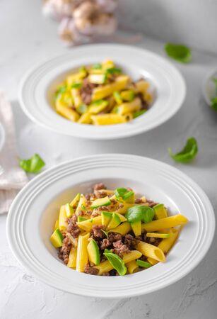 Bio organic avocado and garlic in semolina pasta, fresh beef meat Фото со стока - 134216486