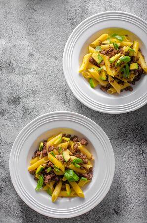 Bio organic avocado and garlic in semolina pasta, fresh beef meat Фото со стока - 134216490