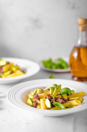 Bio organic avocado and garlic in semolina pasta, fresh beef meat Фото со стока