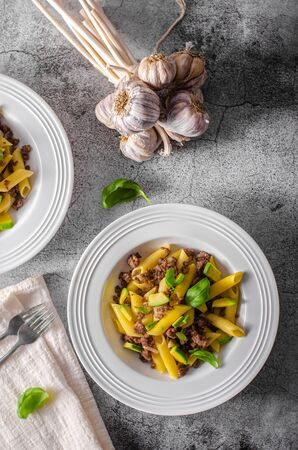 Bio organic avocado and garlic in semolina pasta, fresh beef meat Фото со стока - 134216513