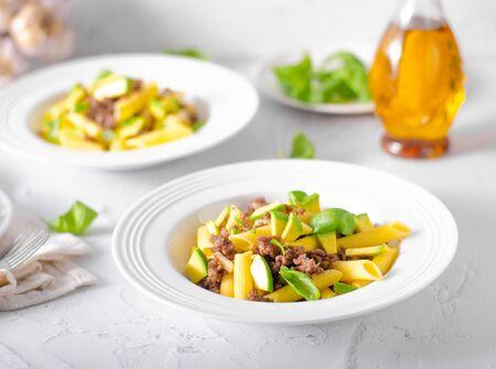 Bio organic avocado and garlic in semolina pasta, fresh beef meat Фото со стока - 134216516
