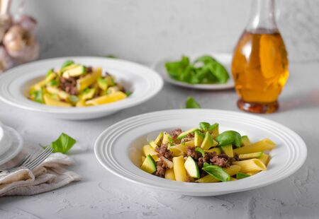 Bio organic avocado and garlic in semolina pasta, fresh beef meat Фото со стока - 134216566