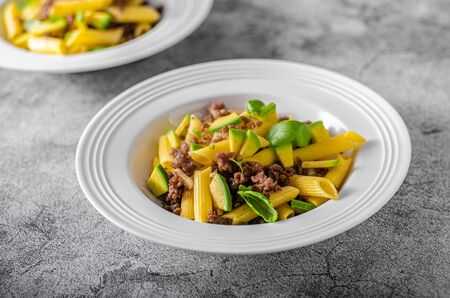 Bio organic avocado and garlic in semolina pasta, fresh beef meat Фото со стока - 134216575
