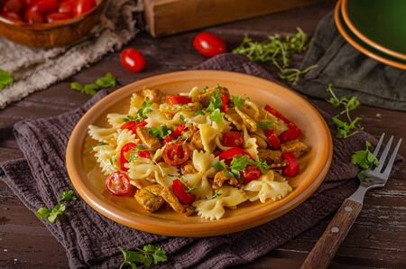 Fresh curry pasta with tomatoes and grilled chicken