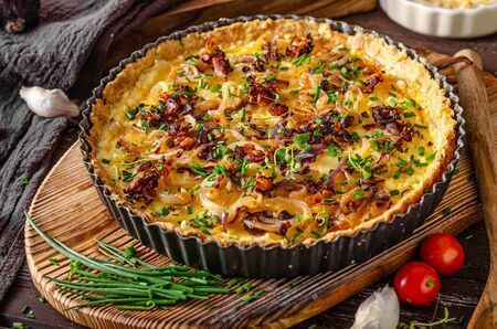 Delicious rustic quiche with roasted onion and crispy bacon