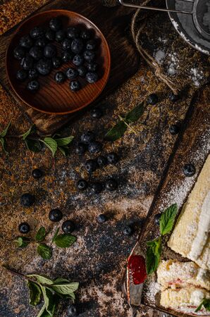 Sweet creamy roulade with berries, forest fruit and mint Stockfoto