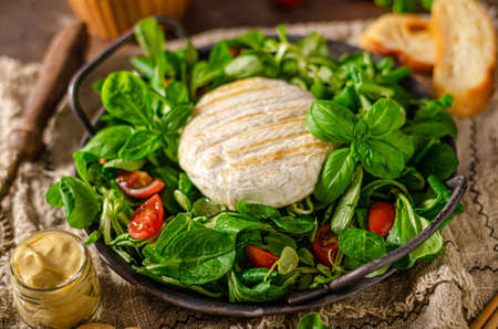 Fresh salad with grilled camembert and dijon mustard