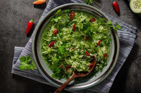 Simple fresh salad with cucumber, vinegar, sugar and chilli Standard-Bild