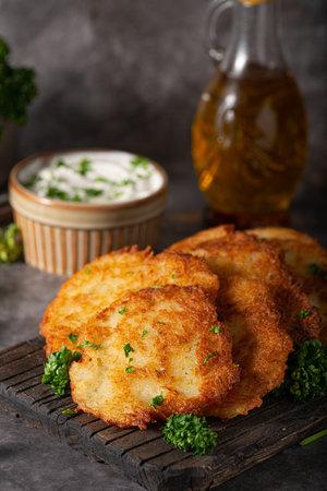 Homemade potato latkes with garlic sour creame and fresh herbs