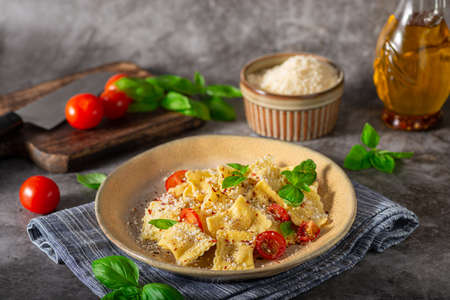 Homemade pasta with parmesan, chilli and fresch cheese inside Standard-Bild