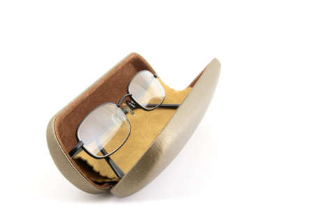 near sighted: Pair of black rimmed metal spectacles in glasses case with Chamois leather cleaning cloth isolated on white