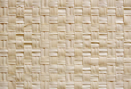 cross hatched: Woven reed table mat for use as background or texture or wallpaper Stock Photo