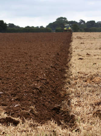 furrow: Freshly ploughed furrow in a field Stock Photo