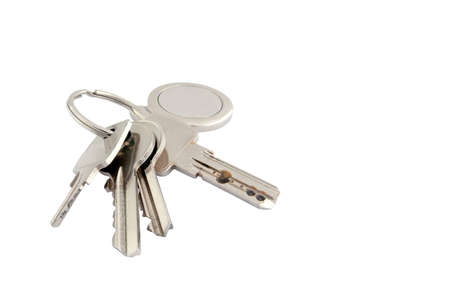 fob: A set of four keys of various types with metal keyring and fob Stock Photo