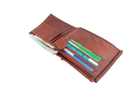 An ope brown leather wallet with bank notes and credit cards visible photo