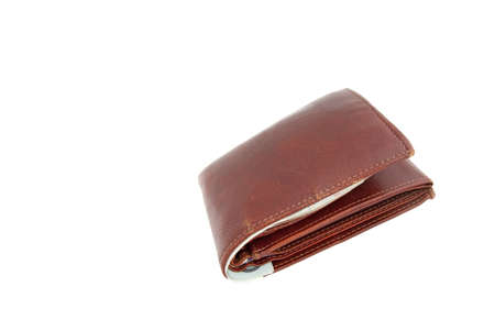 A closed brown leather wallet with bank notes visible photo
