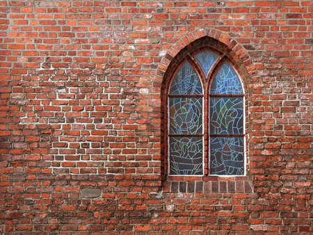 Stained glass church window in brick wall photo