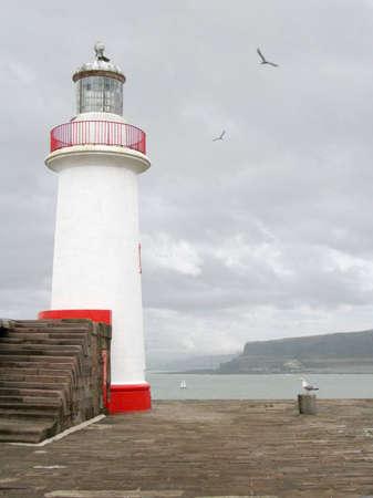 Lighthouse at Whitehaven Harbour, Cumbria, UK photo